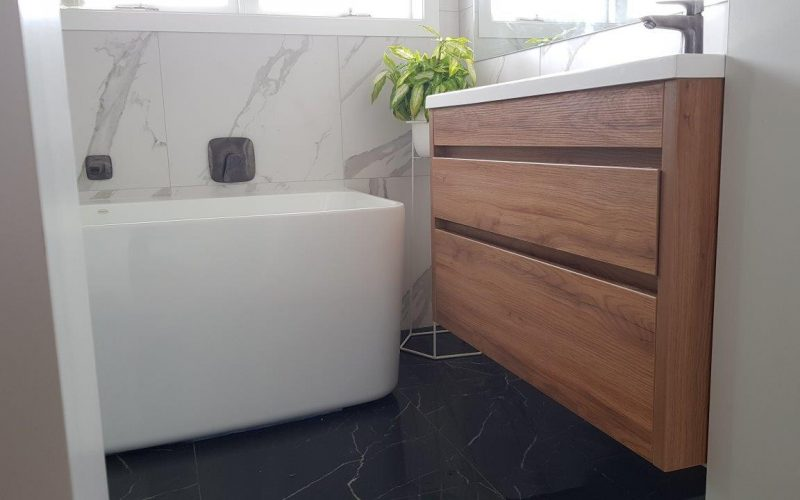 Beautiful Bathroom with marbled tiles and timber vanity